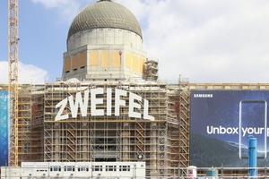 Unbox your castell? So könnten Kreuz und Zweifel am Berliner Schloss zusammengehen