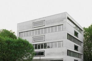 """Das neue """"Schul-Hochhaus"""" ergänzt die gegenüberliegende Primarschule Moos aus den 1970er-Jahren. Es steht an der Stelle, wo ursprünglich ein Wohnhochhaus mit Quartierszentrum geplant war"""