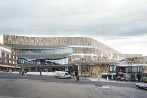 Die horizontal geschichtete Fassadengliederung wird ergänzt durch Lamellenbänder, die vertikal ausgerichtet sind