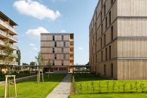 Auf dem Gelände der ehemaligen Hummelkaserne in Graz entstanden die derzeit höchsten Holzwohnungsgebäude in Österreich. Für die Nachbarschaft gibt es gemeinschaftlich nutzbare Flächen, verschiedene Spielplätze sowie Freiflächen zum Urban Gardening