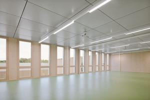 Die Holz-Beton-Verbunddecken sorgen für einen guten Schall- und Brandschutz und wirken als passive Speichermassen für den sommerlichen Hitzeschutz