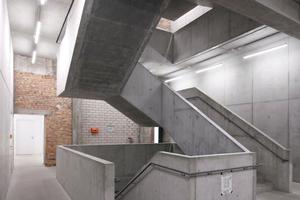 Das Treppenhaus ist als Zutat zum Bestand über den Sichtbeton gekennzeichnet. Die Robustheit der Treppe korrespondiert mit dem Pragmatismus des sichtbaren Materialmixes