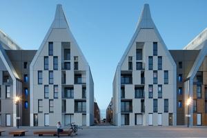 Die Fassaden der Giebelhäuser im Quartier Grand Large im Hafen von Dünkirchen/FR wurden mit vertikalen Faserzementplatten gestaltet und bieten einen ästhetischen und wirkungsvollen Witterungsschutz