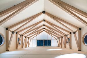 Das Tragwerk der Werk- und Forschungshalle wird aus 13 Dreigelenkrahmen aus Buchen-Furnierschichtholz bestehen