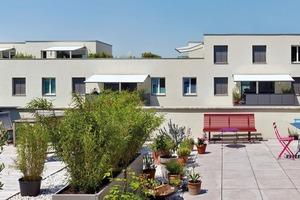 """<div class=""""10.6 Bildunterschrift"""">Die Penthouse- und Maisonettewohnungen ohne Zugang zum Gemeinschaftsgarten verfügen über großzügige Dachterrassen</div>"""