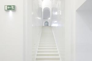 Linke Treppenröhre vom Foyer hinab zum ehemaligen Foyer (Ebene Metzlersaal)