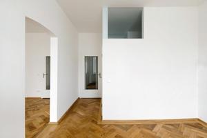 """<div class=""""10.6 Bildunterschrift"""">Die Wohnungen sind über zwei Ebenen konzipiert</div>"""