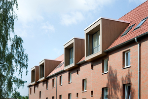 Durchgeschobene Boxen vergrößern die Wohnungen im Dachgeschoss