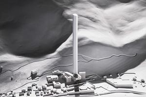 Auf der Modelldarstellung ist die Therme Zumthors (links am Fuß) sowie die Landschaftsgestaltung durch Tadao Ando (Planung, vor dem Turm) deutlich zu sehen