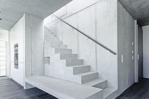 """<div class=""""13.6 Bildunterschrift"""">Dachgeschoss: Raumteiler und Funktionsmöbel in einem, und alles besteht aus Beton</div>"""