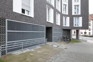 Offene Kellerräume (Fahrradkeller) hinter Gittern