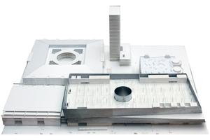 Der Hallenneubau ist eine 3-geschossige Verlängerung der Halle 1. Das zentrale architektonische und städtebauliche Element ist eine offene Halle, die von oben belichtet wird