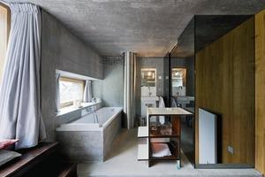Sogar im Bad setzt sich das Sichtbeton-Konzept weiter fort<br />