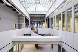 Ein klares Erschließungskonzept zoniert den vorhandenen Hallenbaukörper