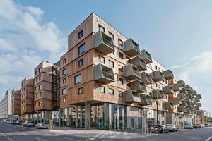 Der Wohnungsbau von Berger+Parkkinen und querkraft ist das erste Gebäude in Wien mit einer sichtbaren Holzfassade bei einer Gebäudehöhe von 21m, weil der Brandüberschlag von Geschoss auf Geschoss vermieden werden konnte