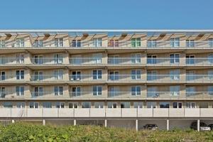 Von dem 2-teiligen Ensemble mit 88 Appartements und 27 Reihenhäusern wurden aufgrund der Wirtschaftskrise und der Unverkäuflichkeit der Eigentumswohnungen vorerst nur die Sozialwohnungen fertiggestellt. Die Vestia forderte aufgrund der Alters- und Behinderten-gerechtigkeit explizit 1-geschossige Wohnungen mit einer durchschnittlichen Wohnfläche von 95m²