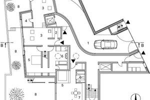Grundriss Erdgeschoss, M 1 : 333 1/3Legende Grundrisse Erdgeschoss bis 2. Obergeschoss<br /><br /><br />1Rampe Tiefgarage<br />2Garderobe<br />3Wohnen<br />4Arbeiten<br />5Schlafen<br />6Bad<br />7Küche<br />8Terrasse<br />9Eingang<br />10 Kochen/ Essen<br />11 Patio<br />12 Innenhof<br />13 Ankleide<br />14 Kammer<br />15 Studio<br />16 Luftraum<br /><br />