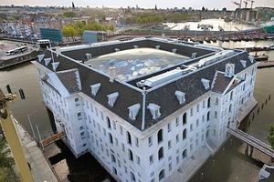 Eine doppelt gekrümmte Dachschale war die Lösung für die Überdachung des Innenhofes