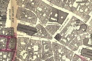 Die Karte von 1878 zeigt eine St. Nikolauskirche, die von gedrungenden, sich eng an die Kirchenmauern schmiegenden Handwerkers-, Wohn und Geschäftshäusern gesäumt ist. Im Bereich der Apsis wächst diese Bebauung zu einem unregelmäßigen Häuserblock aus