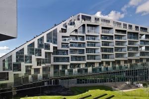An der Fassade sind die verschiedenen Wohntypologien von Reihenhaus bis Apartment ablesbar<br />