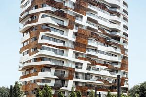 """In der Fassade derCityLife Residenzen sorgen Sonderanfertigungen von Schüco<br />Italia für Wind- und<br />Regenschutz. Die unterschiedlich dimensionierten Paneele und Naturholzflächen sind kombiniert mit dem objektspezifisch modifizierten Fassadensystem Schüco FW 60+ und Spezialversionen der Aluminium Fensterkonstruktion Schüco AWS 75. Unterbrochen sind die raumhohen Verglasungen vielerorts durch das Schiebe- und Hebeschiebesystem Schüco ASS 50, das barrierefreien Zutritt auf die Balkone gewährtSchüco Interntional KG<br /><a href=""""http://www.schueco.de"""" target=""""_blank"""">www.schueco.de</a>"""
