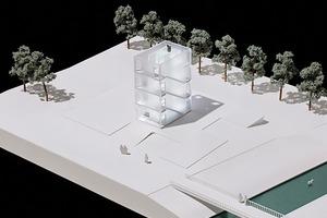 Das Schachteltreppenhaus verbindet die zwei Zonen des Wohnens und des Arbeitens zu einem Gebäude