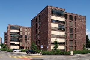 Die würfelförmigen Gebäude mit den ausdrucksstarken Klinkerfassaden verleihen dem City Park Oberhof in Emmen/CH eine hochwertiges und zeitloses Erscheinungsbild.